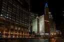 The lighted centerpiece of this shot is the Wrigley Building.  IT is situated along the Chicago River and sits on Michigan Avenue at the beginning of the fames Magnificent Mile.  The building at the foreground is the base of the newly constructed massive Trump Tower.